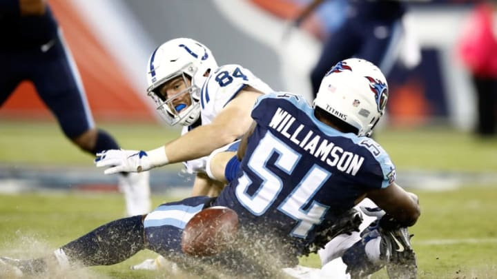 NASHVILLE, TN - OCTOBER 16: Jack Doyle #84 of the Indianapolis Colts fumbles the ball as he is tackled by Avery Williamson #54 of the Tennessee Titans during the game at Nissan Stadium on October 16, 2017 in Nashville, Tennessee. (Photo by Andy Lyons/Getty Images)