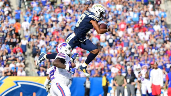 CARSON, CA - NOVEMBER 19: Tyrell Williams #16 of the Los Angeles Chargers leaps over Micah Hyde #23 of the Buffalo Bills during the game at the StubHub Center on November 19, 2017 in Carson, California. (Photo by Harry How/Getty Images)