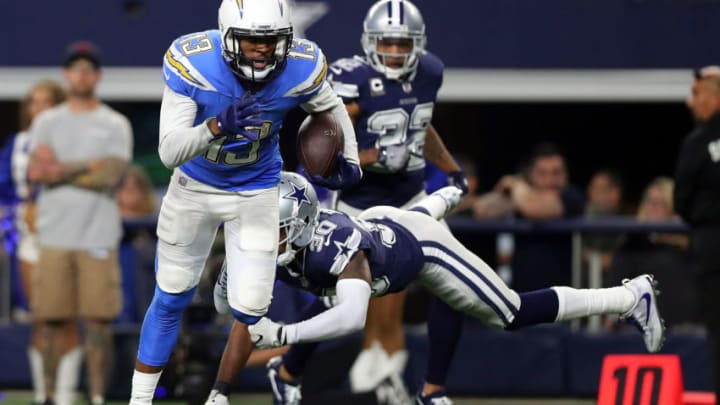 ARLINGTON, TX - NOVEMBER 23: Keenan Allen #13 of the Los Angeles Chargers breaks tackle by Anthony Brown #30 of the Dallas Cowboys on a touchdown run in the fourth quarter at AT&T Stadium on November 23, 2017 in Arlington, Texas. (Photo by Tom Pennington/Getty Images)