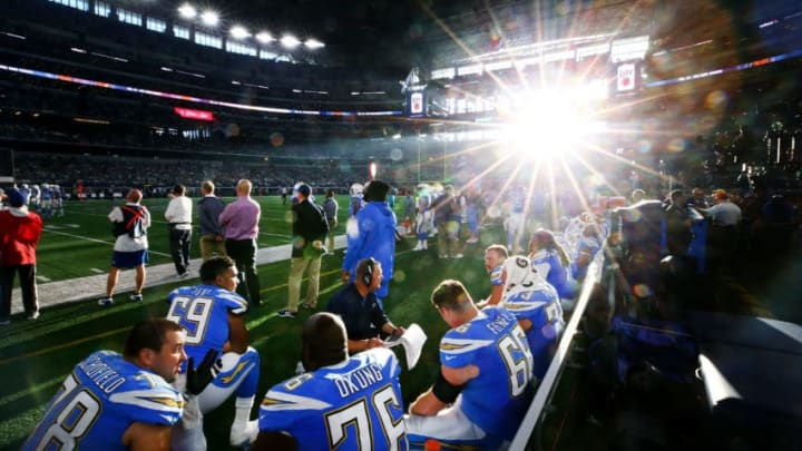ARLINGTON, TX - NOVEMBER 23: The Los Angeles Chargers offensive line sits on the bench as the Los Angeles Chargers take on the Dallas Cowboy at AT
