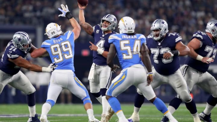 ARLINGTON, TX - NOVEMBER 23: Dak Prescott #4 of the Dallas Cowboys looks for an open receiver against Joey Bosa #99 of the Los Angeles Chargers and Melvin Ingram #54 of the Los Angeles Chargers at AT&T Stadium on November 23, 2017 in Arlington, Texas. (Photo by Tom Pennington/Getty Images)