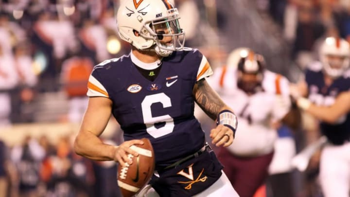 CHARLOTTESVILLE, VA - NOVEMBER 24: Kurt Benkert #6 of the Virginia Cavaliers scrambles in the second quarter during a game against the Virginia Tech Hokies at Scott Stadium on November 24, 2017 in Charlottesville, Virginia. (Photo by Ryan M. Kelly/Getty Images)
