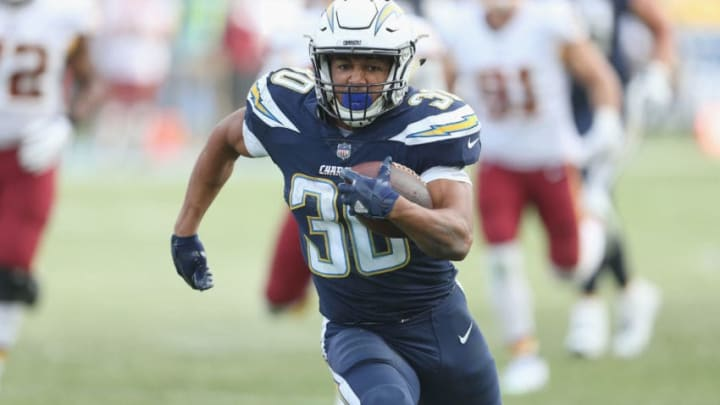 CARSON, CA - DECEMBER 10: Running back Austin Ekeler #30 of the Los Angeles Chargers carries the ball on a 33 yard run down to the Washington Redskins four yard line on the final play of the first half on December 10, 2017 at StubHub Center in Carson, California. (Photo by Stephen Dunn/Getty Images)