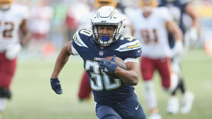 CARSON, CA – DECEMBER 10: Running back Austin Ekeler #30 of the Los Angeles Chargers carries the ball on a 33 yard run down to the Washington Redskins four yard line on the final play of the first half on December 10, 2017 at StubHub Center in Carson, California. (Photo by Stephen Dunn/Getty Images)
