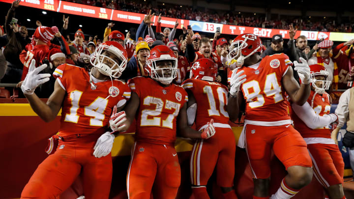 KANSAS CITY, MO – DECEMBER 16: Running back Kareem Hunt #27 of the Kansas City Chiefs celebrates with teammates in the endzone after scoring a touchdown during the game against the Los Angeles Chargers at Arrowhead Stadium on December 16, 2017 in Kansas City, Missouri. (Photo by Jamie Squire/Getty Images)