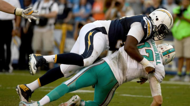 SAN DIEGO - NOVEMBER 13: Corey Liuget #94 of the San Diego Chargers pressures Ryan Tannehill #17 of the Miami Dolphins during the second half at Qualcomm Stadium on November 13, 2016 in San Diego, California. (Photo by Donald Miralle/Getty Images)