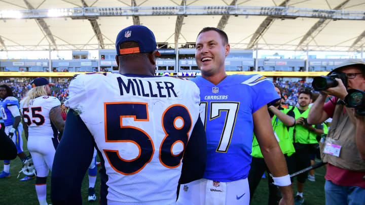 CARSON, CA – OCTOBER 22: Philip Rivers #17 of the Los Angeles Chargers shakes hands with Von Miller #58 of the Denver Broncos after a 21-0 win over the Denver Broncos at StubHub Center on October 22, 2017 in Carson, California. (Photo by Harry How/Getty Images)