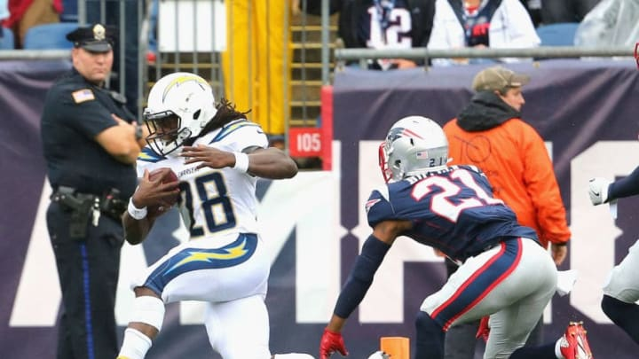FOXBORO, MA - OCTOBER 29: Melvin Gordon #28 of the Los Angeles Chargers evades the tackle of Malcolm Butler #21 of the New England Patriots as he scores a touchdown during the first quarter of a game at Gillette Stadium on October 29, 2017 in Foxboro, Massachusetts. (Photo by Maddie Meyer/Getty Images)