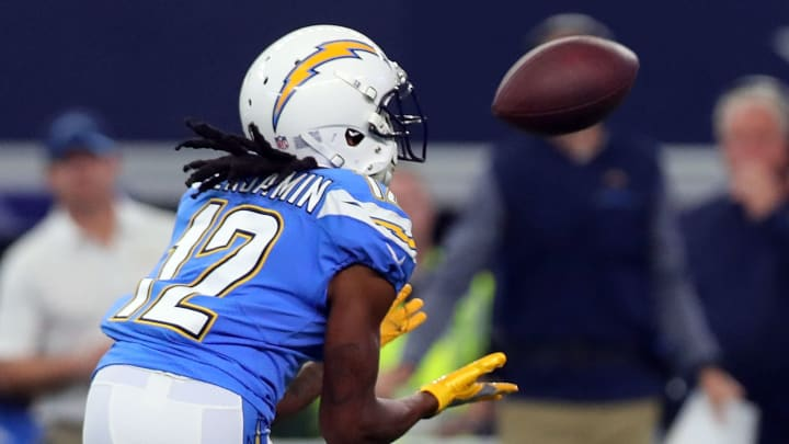 ARLINGTON, TX – NOVEMBER 23: Travis Benjamin #12 of the Los Angeles Chargers catches a pass in the first quarter of a football game against the Dallas Cowboys at AT&T Stadium on November 23, 2017 in Arlington, Texas. (Photo by Tom Pennington/Getty Images)