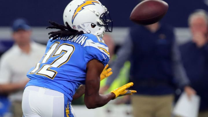 ARLINGTON, TX - NOVEMBER 23: Travis Benjamin #12 of the Los Angeles Chargers catches a pass in the first quarter of a football game against the Dallas Cowboys at AT&T Stadium on November 23, 2017 in Arlington, Texas. (Photo by Tom Pennington/Getty Images)