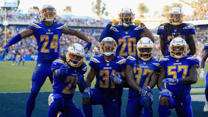 CARSON, CA - DECEMBER 03: Trevor Williams #24, Rayshawn Jenkins #25, Adrian Phillips #31, Casey Hayward #26, Jahleel Addae #37, Jatavis Brown #57, and Michael Davis #43 of the Los Angeles Chargers celebrate recovering a fumble during the fourth quarter of a game against the Cleveland Browns at StubHub Center on December 3, 2017 in Carson, California. (Photo by Sean M. Haffey/Getty Images)