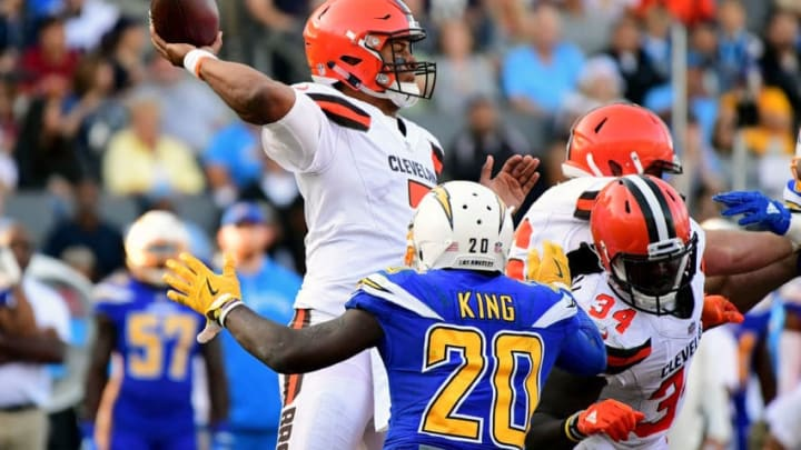 CARSON, CA - DECEMBER 03: DeShone Kizer #7 of the Cleveland Browns passes in the pocket as he is rushed by Desmond King #20 of the Los Angeles Chargers during the third quarter of the game at StubHub Center on December 3, 2017 in Carson, California. (Photo by Harry How/Getty Images)
