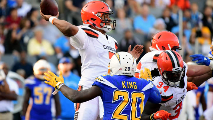CARSON, CA – DECEMBER 03: DeShone Kizer #7 of the Cleveland Browns passes in the pocket as he is rushed by Desmond King #20 of the Los Angeles Chargers during the third quarter of the game at StubHub Center on December 3, 2017 in Carson, California. (Photo by Harry How/Getty Images)