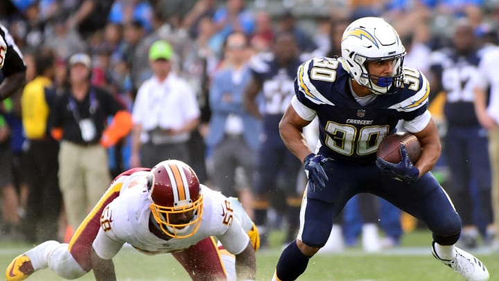 CARSON, CA – DECEMBER 10: Austin Ekeler #30 of the Los Angeles Chargers breaks the tackle of Junior Galette #58 of the Washington Redskins during the second quarter at StubHub Center on December 10, 2017 in Carson, California. (Photo by Harry How/Getty Images)