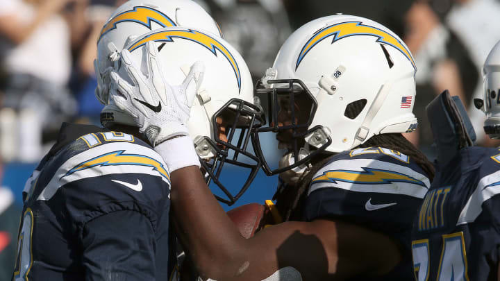 CARSON, CA – DECEMBER 31: Melvin Gordon #28 of the Los Angeles Chargers and Keenan Allen #13 of the Los Angeles Chargers celebrate after scoring a touchdown during the first half of the game against the Oakland Raiders at StubHub Center on December 31, 2017 in Carson, California. (Photo by Stephen Dunn/Getty Images)