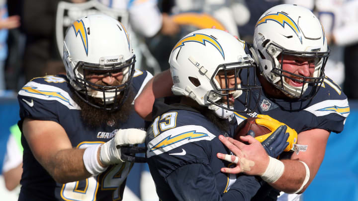 CARSON, CA – DECEMBER 31: Keenan Allen #13 of the Los Angeles Chargers, Derek Watt #34, and Spencer Pulley #73 celebrate after a touchdown during the first half of the game against the Oakland Raiders at StubHub Center on December 31, 2017 in Carson, California. (Photo by Stephen Dunn/Getty Images)