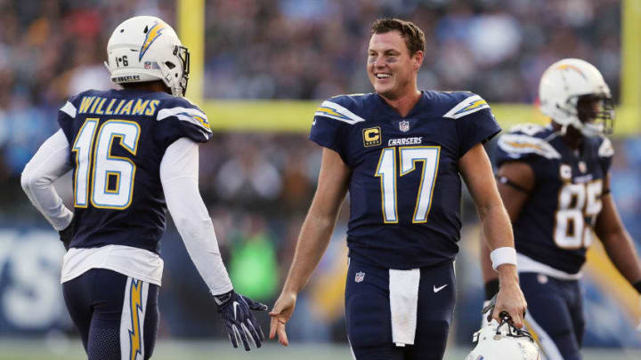 CARSON, CA - DECEMBER 31: Tyrell Williams #16 of the Los Angeles Chargers and Philip Rivers #17 of the Los Angeles Chargers shake hands during the first half of the game against the Oakland Raiders at StubHub Center on December 31, 2017 in Carson, California. (Photo by Stephen Dunn/Getty Images)