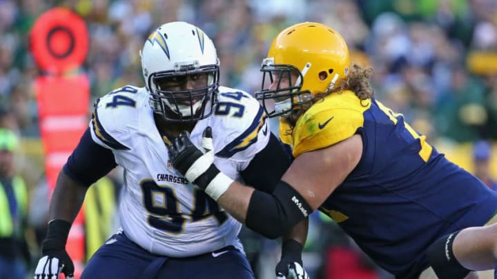 GEEN BAY, WI - OCTOBER 18: Corey Liuget #94 of the San Diego Chargers rushes against Josh Sitton #71 of the Green Bay Packers at Lambeau Field on October 18, 2015 in Green Bay, Wisconsin. The Packers defeated the Chargers 27-20. (Photo by Jonathan Daniel/Getty Images)