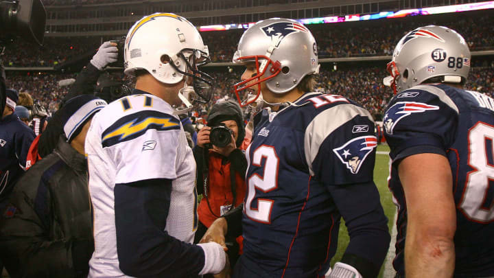 FOXBORO, MA – JANUARY 20: Tom Brady #12 of the New England Patriots is congratulated by Philip Rivers #17 of the San Diego Chargers after the Patriots 21-12 win in the AFC Championship Game on January 20, 2008 at Gillette Stadium in Foxboro, Massachusetts. (Photo by Al Bello/Getty Images)