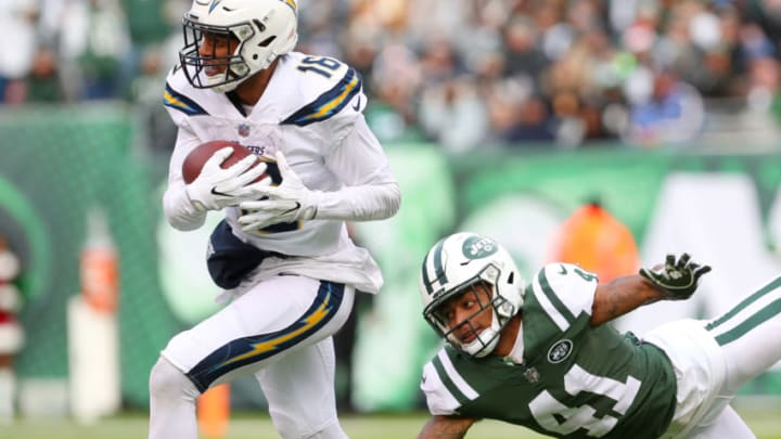 EAST RUTHERFORD, NJ - DECEMBER 24: Tyrell Williams #16 of the Los Angeles Chargers carries the ball past Buster Skrine #41 of the New York Jets during the first half in an NFL game at MetLife Stadium on December 24, 2017 in East Rutherford, New Jersey. (Photo by Ed Mulholland/Getty Images)