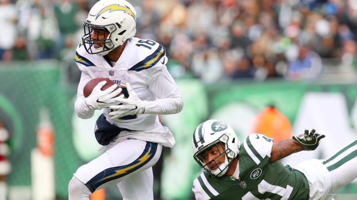 EAST RUTHERFORD, NJ – DECEMBER 24: Tyrell Williams #16 of the Los Angeles Chargers carries the ball past Buster Skrine #41 of the New York Jets during the first half in an NFL game at MetLife Stadium on December 24, 2017 in East Rutherford, New Jersey. (Photo by Ed Mulholland/Getty Images)