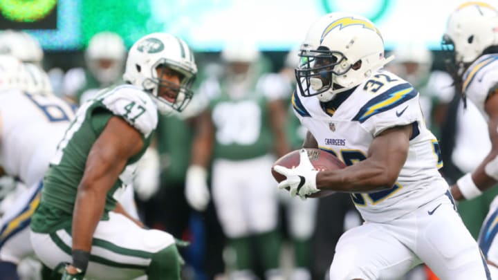 EAST RUTHERFORD, NJ - DECEMBER 24: Branden Oliver #32 of the Los Angeles Chargers runs the ball during the first half against the New York Jets in an NFL game at MetLife Stadium on December 24, 2017 in East Rutherford, New Jersey. (Photo by Ed Mulholland/Getty Images)