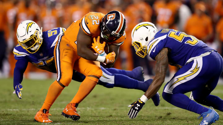 SAN DIEGO, CA – OCTOBER 13: Jatavis Brown #57 and Korey Toomer #56 of the San Diego Chargers tackle C.J. Anderson #22 of the Denver Broncos during the second half of a game at Qualcomm Stadium on October 13, 2016 in San Diego, California. (Photo by Sean M. Haffey/Getty Images)