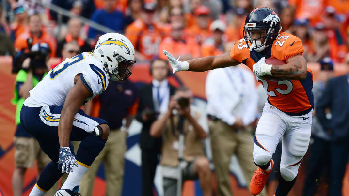 DENVER, CO – OCTOBER 30: Running back Devontae Booker #23 of the Denver Broncos reaches out to stiff arm inside linebacker Joshua Perry #53 of the San Diego Chargers in the first quarter of the game at Sports Authority Field at Mile High on October 30, 2016 in Denver, Colorado. (Photo by Dustin Bradford/Getty Images)