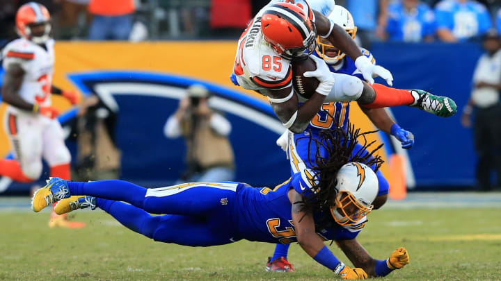 CARSON, CA – DECEMBER 03: Tre Boston #33 of the Los Angeles Chargers upends David Njoku #85 of the Cleveland Browns on a short pass play during the second half of a game at StubHub Center on December 3, 2017 in Carson, California. (Photo by Sean M. Haffey/Getty Images)