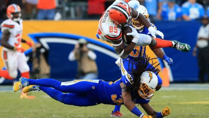 CARSON, CA - DECEMBER 03: Tre Boston #33 of the Los Angeles Chargers upends David Njoku #85 of the Cleveland Browns on a short pass play during the second half of a game at StubHub Center on December 3, 2017 in Carson, California. (Photo by Sean M. Haffey/Getty Images)