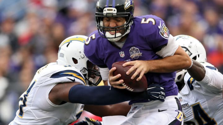 BALTIMORE, MD - NOVEMBER 01: Quarterback Joe Flacco #5 of the Baltimore Ravens is sacked by a pair of San Diego Chargers defenders during the second half at M&T Bank Stadium on November 1, 2015 in Baltimore, Maryland. (Photo by Patrick Smith/Getty Images)