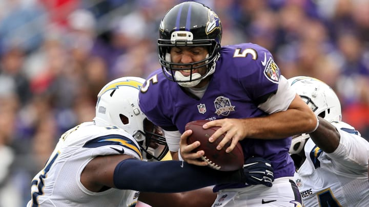 BALTIMORE, MD – NOVEMBER 01: Quarterback Joe Flacco #5 of the Baltimore Ravens is sacked by a pair of San Diego Chargers defenders during the second half at M&T Bank Stadium on November 1, 2015, in Baltimore, Maryland. (Photo by Patrick Smith/Getty Images)