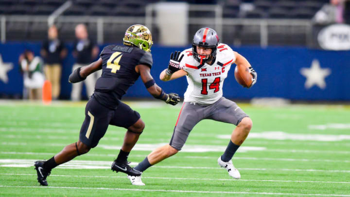 LUBBOCK, TX - NOVEMBER 11: Dylan Cantrell #14 of the Texas Tech Red Raiders tries to get by Grayland Arnold #4 of the Baylor Bears during the first half of the game between the Baylor Bears and the Texas Tech Red Raiders on November 11, 2017 at AT&T Stadium in Arlington, Texas. (Photo by John Weast/Getty Images)