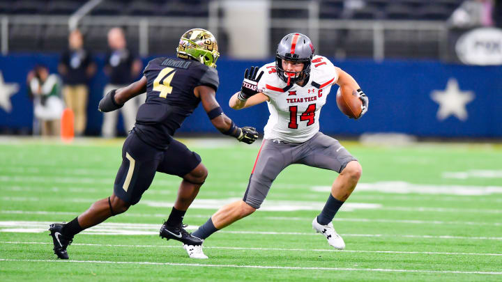 LUBBOCK, TX – NOVEMBER 11: Dylan Cantrell #14 of the Texas Tech Red Raiders tries to get by Grayland Arnold #4 of the Baylor Bears during the first half of the game between the Baylor Bears and the Texas Tech Red Raiders on November 11, 2017 at AT&T Stadium in Arlington, Texas. (Photo by John Weast/Getty Images)