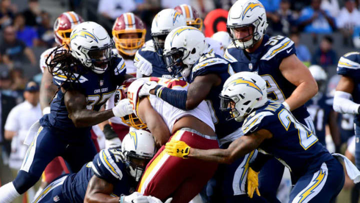 CARSON, CA - DECEMBER 10: Samaje Perine #32 of the Washington Redskins runs into the Los Angeles Chargers defense during the first quarter at StubHub Center on December 10, 2017 in Carson, California. (Photo by Harry How/Getty Images)