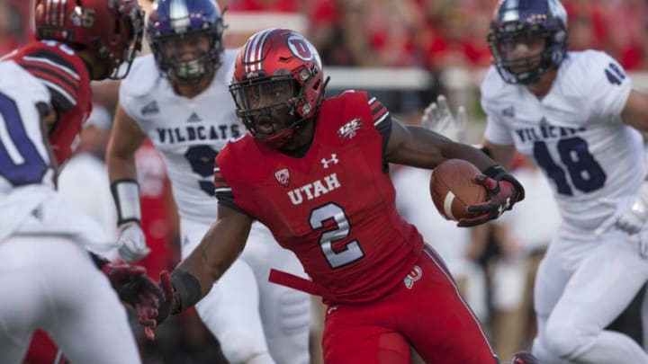 SALT LAKE CITY, UT- AUGUST 30: Zack Moss #2 of the Utah Utes rushes the ball against the Weber State Wildcats at Rice-Eccles Stadium on August 30, 2018 in Salt Lake City, Utah. (Photo by Chris Gardner/Getty Images)