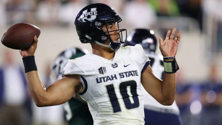 EAST LANSING, MI - AUGUST 31: Jordan Love #10 of the Utah State Aggies throws a second half pass while playing the Michigan State Spartans at Spartan Stadium on August 31, 2018 in East Lansing, Michigan. Michigan State won the game 38-31. (Photo by Gregory Shamus/Getty Images)