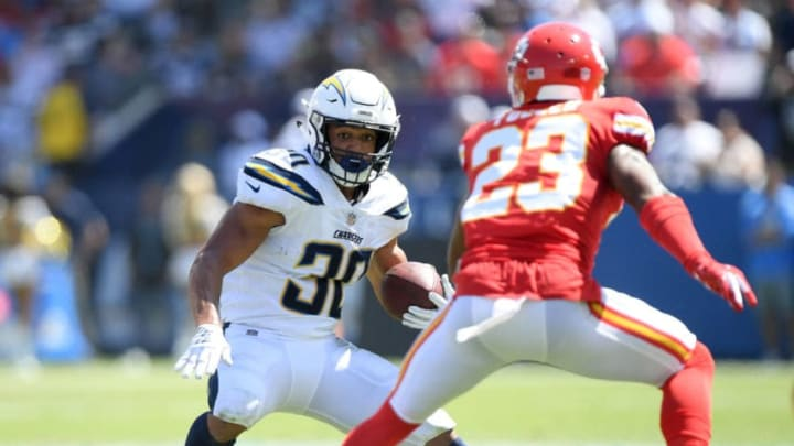 CARSON, CA - SEPTEMBER 09: Austin Ekeler #30 of the Los Angeles Chargers cuts back on Kendall Fuller #23 of the Kansas City Chiefs during the first quarter at StubHub Center on September 9, 2018 in Carson, California. (Photo by Harry How/Getty Images)