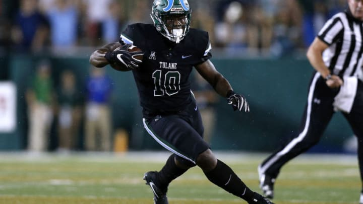 NEW ORLEANS, LA - SEPTEMBER 28: Darius Bradwell #10 of the Tulane Green Wave runs with the ball during a game against the Memphis Tigers at Yulman Stadium on September 28, 2018 in New Orleans, Louisiana. (Photo by Jonathan Bachman/Getty Images)