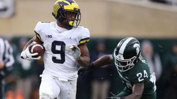 EAST LANSING, MI - OCTOBER 20: Donovan Peoples-Jones #9 of the Michigan Wolverines catches a second half touchdown and avoids the tackle of Tre Person #24 the Michigan State Spartans at Spartan Stadium on October 20, 2018 in East Lansing, Michigan. (Photo by Gregory Shamus/Getty Images)