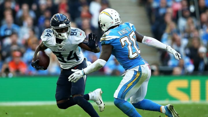 LONDON, ENGLAND – OCTOBER 21: Corey Davis #84 of the Tennessee Titans fends off Desmond King #20 of the Los Angeles Chargers during the NFL International Series game between Tennessee Titans and Los Angeles Chargers at Wembley Stadium on October 21, 2018, in London, England. (Photo by Jack Thomas/Getty Images)