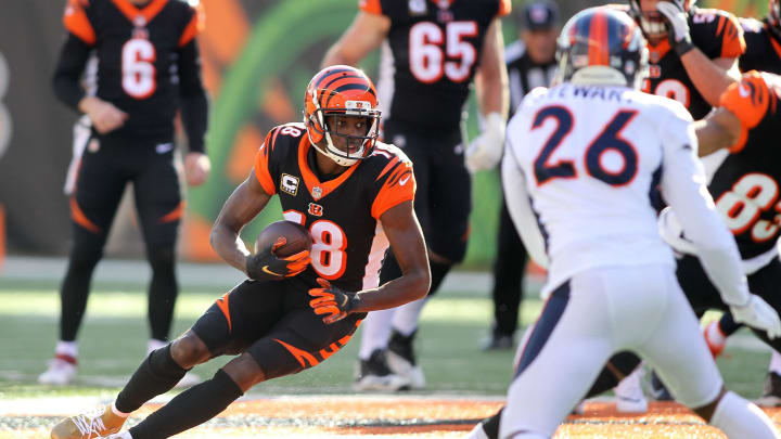 CINCINNATI, OH – DECEMBER 2: A.J. Green #18 of the Cincinnati Bengals runs with the ball during the first quarter of the game against the Denver Broncos at Paul Brown Stadium on December 2, 2018, in Cincinnati, Ohio. (Photo by John Grieshop/Getty Images)