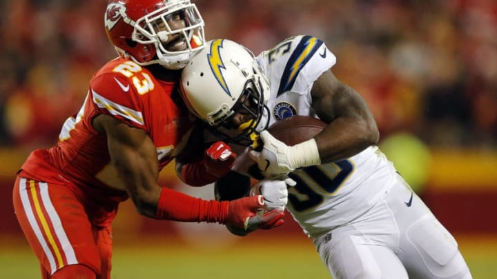 KANSAS CITY, MISSOURI - DECEMBER 13: Running back Austin Ekeler #30 of the Los Angeles Chargers carries the ball as cornerback Kendall Fuller #23 of the Kansas City Chiefs defends during the game at Arrowhead Stadium on December 13, 2018 in Kansas City, Missouri. (Photo by David Eulitt/Getty Images)