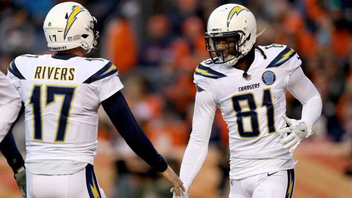 DENVER, COLORADO – DECEMBER 30: Quarterback Philip Rivers #17 and wide receiver Mike Williams #81 of the Los Angeles Chargers celebrate a touchdown against the Denver Broncos at Broncos Stadium at Mile High on December 30, 2018, in Denver, Colorado. (Photo by Matthew Stockman/Getty Images)