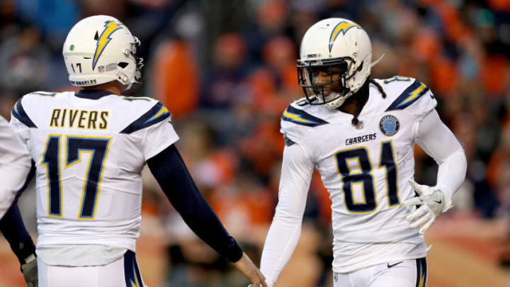 DENVER, COLORADO - DECEMBER 30: Quarterback Philip Rivers #17 and wide receiver Mike Williams #81 of the Los Angeles Chargers celebrate a touchdown against the Denver Broncos at Broncos Stadium at Mile High on December 30, 2018 in Denver, Colorado. (Photo by Matthew Stockman/Getty Images)