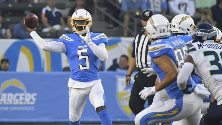 CARSON, CA – AUGUST 24: Tyrod Taylor #5 of the Los Angeles Chargers throws a short pass against the Seattle Seahawks in the first quarter during a preseason NFL football game at Dignity Health Sports Park on August 24, 2019, in Carson, California. (Photo by John McCoy/Getty Images)