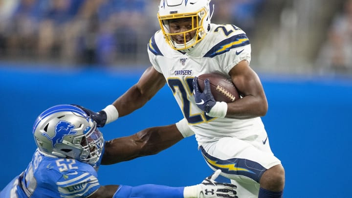 DETROIT, MI – SEPTEMBER 15: Justin Jackson #22 of the Los Angeles Chargers runs for a short gain as Christian Jones #52 of the Detroit Lions makes the stop during the third quarter of the game at Ford Field on September 15, 2019, in Detroit, Michigan. Detroit defeated Los Angeles 13-10. (Photo by Leon Halip/Getty Images)