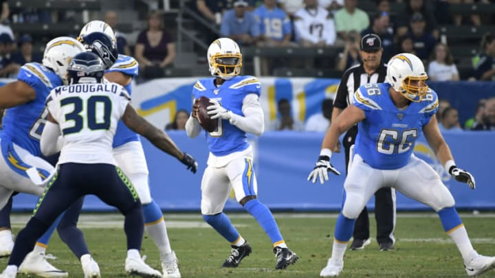 CARSON, CA - AUGUST 24: Bradley McDougald #30 of the Seattle Seahawks rushes while Tyrod Taylor #5 of the Los Angeles Chargers drops back to pass and Dan Feeney #66 of the Los Angeles Chargers blocks during a preseason NFL football game at Dignity Health Sports Park on August 24, 2019 in Carson, California. The Seattle Seahawks won 23-15. (Photo by John McCoy/Getty Images)