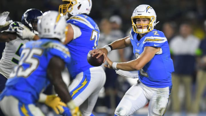 CARSON, CA - AUGUST 24: Easton Stick #2 of the Los Angeles Chargers scrambles while playing the Seattle Seahawks during a preseason NFL football game at Dignity Health Sports Park on August 24, 2019 in Carson, California. (Photo by John McCoy/Getty Images)