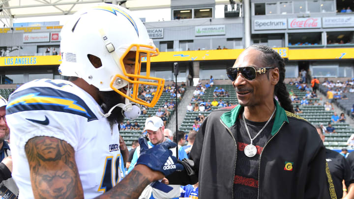 CARSON, CA – SEPTEMBER 22: Rapper Snoop Dogg talks with wide receiver Keenan Allen #13 of the Los Angeles Chargers before the game against the Houston Texans at Dignity Health Sports Park on September 22, 2019 in Carson, California. (Photo by Jayne Kamin-Oncea/Getty Images)